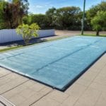 A light blue custom solar pool cover