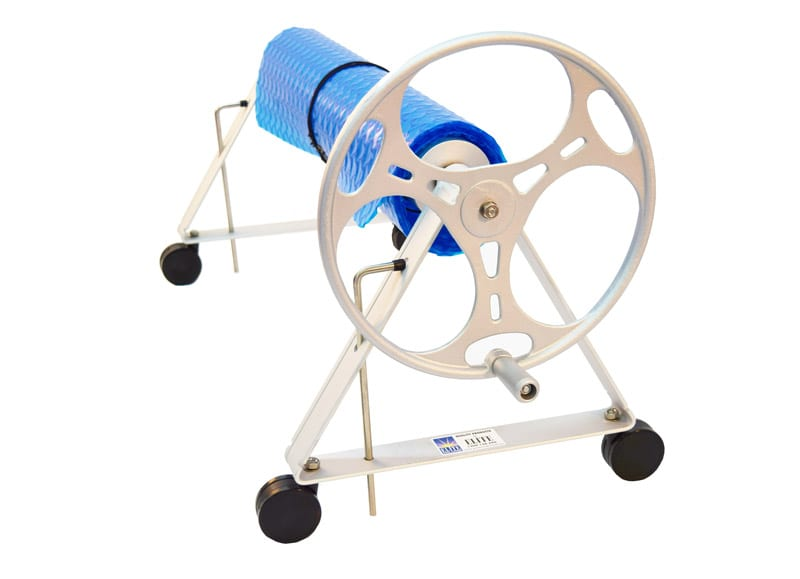 Blue swimming pool cover rolled and tied to white roller with rotating wheel