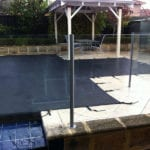 Swimming Pool covered with black mesh cover