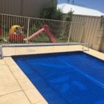 A swimming pool and a fence around it