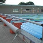Cover roller around a swimming pool