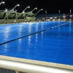 A large swimming pool captured in the night