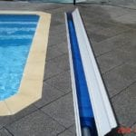 Swimming pool cover roller around the pool