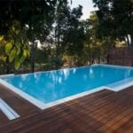 Swimming pool with wooden flooring around it
