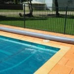 A corner of a swimming covered with pool cover