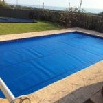 Small swimming pool covered with blue cover