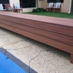 Wooden Bench around a swimming pool