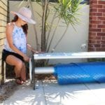 A woman checking a pool cover roller