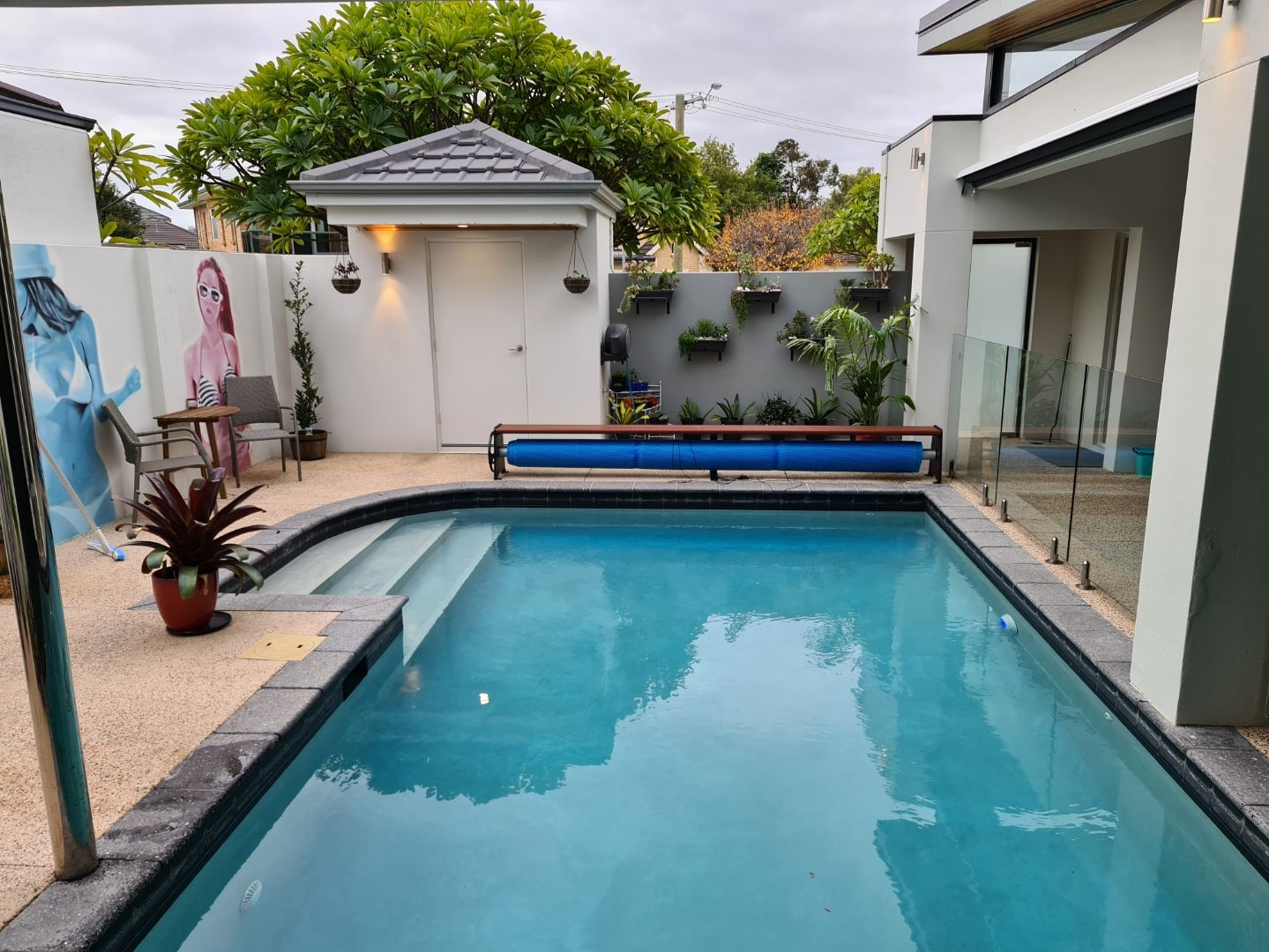 Combo Seat in backyard with uncovered pool