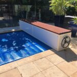 Black Bench seat with covered pool